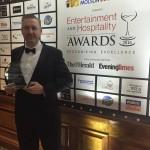 Andrew Scott holding trophy